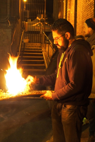 Lighting the fire.